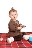 Baby girl sitting on blanket. Royalty Free Stock Photo