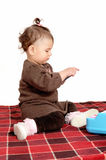 Baby girl sitting on blanket. Stock Photography