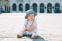 Baby on a european city street in Italy stock images