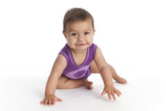Baby girl sitting on the floor Stock Photography
