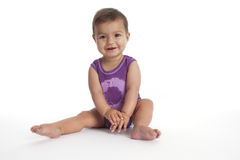 Baby girl sitting on the floor  Stock Photos