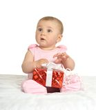 Baby girl sitting  with gift Stock Photography