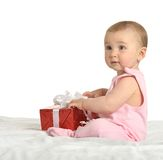 Baby girl sitting  with gift Royalty Free Stock Photography