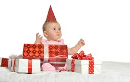 Baby girl sitting  with gifts Royalty Free Stock Photo