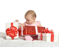 Baby girl sitting  with gifts Stock Photos
