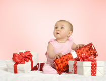 Baby girl sitting  with gifts Royalty Free Stock Images