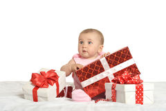 Baby girl sitting  with gifts Royalty Free Stock Image