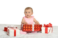 Baby girl sitting  with gifts Stock Photography