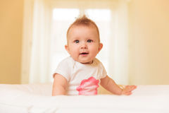 Baby girl sitting in her crib Royalty Free Stock Photo
