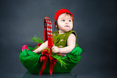 Baby girl sitting in the image of berries Royalty Free Stock Images