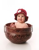 Baby Girl Sitting In A Flower Pot Stock Images