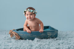 Baby Girl Sitting in a Little Boat stock images