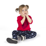 Baby girl sitting and make a gesture with hands Royalty Free Stock Photos