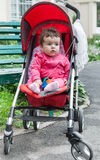 Baby girl sitting in pram Royalty Free Stock Image
