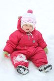 Baby girl sitting in the snow. Happy baby girl sitting in the snow Stock Images