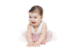 Baby girl sitting in studio on white background Royalty Free Stock Photography