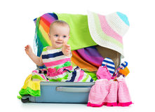 Baby girl sitting in suitcase Stock Photography