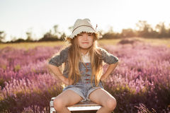 Baby girl sitting on top stepladder outdoors Royalty Free Stock Photos