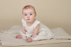 Baby Girl Sitting Up Stock Photo