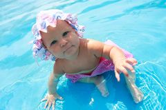 Baby girl sitting in waterpool Stock Photo
