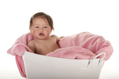 Baby girl sitting in white tub Royalty Free Stock Photos