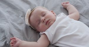 Baby girl sleeping on bed. Cute baby girl sleeping on bed at home stock video footage