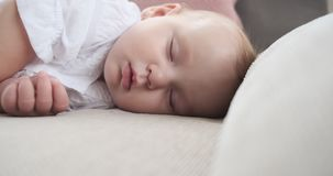Baby girl sleeping on bed. At home stock video