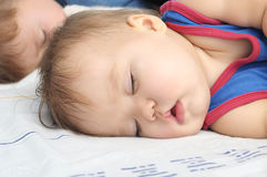 Baby girl sleeping with brother Royalty Free Stock Photo