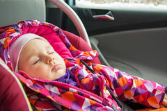 Baby girl sleeping in car Stock Images