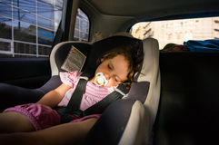 Baby girl sleeping in the car. Cute baby girl sleeping in the car seat Royalty Free Stock Image