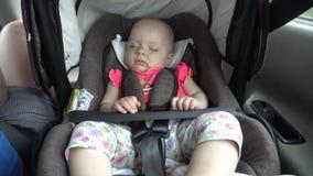 Baby Girl Sleeping in Child Car Seat. Royalty Free Stock Photos