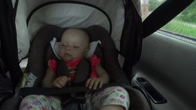 Baby Girl Sleeping in Child Car Seat. Royalty Free Stock Images