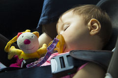 Baby girl sleeping in the child car seat Royalty Free Stock Image