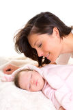 Baby girl sleeping with mother care near Royalty Free Stock Photo