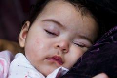 Baby Girl Sleeping on Shoulders Stock Photo