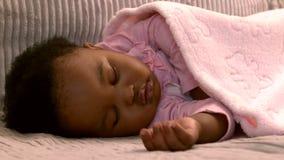 Baby girl sleeping on the sofa stock footage