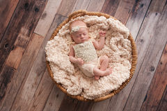 Baby Girl Sleeping in a Wicker Basket Stock Photography