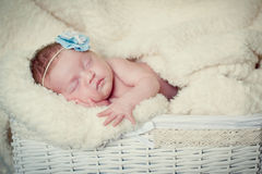 Baby girl sleeps on a blanket Stock Image