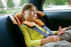 Baby girl sleeps in car Royalty Free Stock Photography