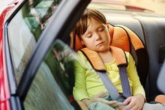 Baby girl sleeps in car Stock Images