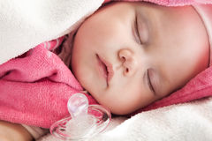 Baby Girl Sleeps With A Pacifier Nearby Stock Photos