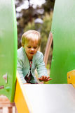Baby girl  on slide Stock Photography