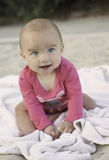 Baby Girl With Smile on Blanket Stock Photography