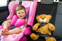 Baby girl smile in car Stock Image