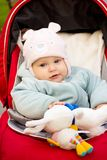 Baby girl smile in car stroller Royalty Free Stock Photography