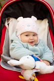 Baby girl smile in car stroller Stock Images