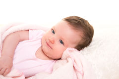 Baby girl smiling dress in pink with white fur Royalty Free Stock Images