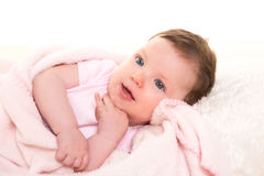 Baby girl smiling dress in pink with white fur Stock Photo