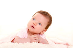 Baby girl smiling dress in pink with white fur Stock Photography