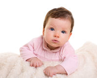Baby girl smiling  in pink with winter white fur blanket Stock Photo